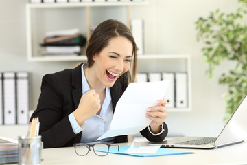 Excited office worker reading a letter
