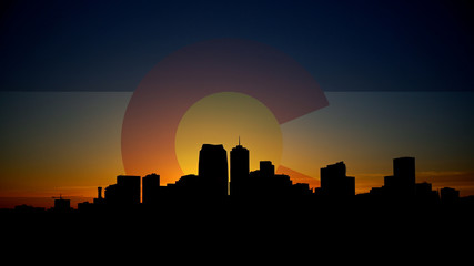 Denver Skyline Sunrise with Colorado Flag in Sky