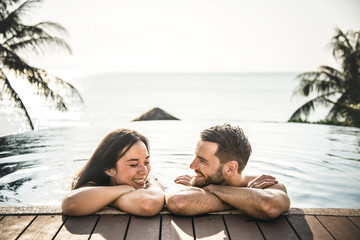 Couple relaxing in a swimming pool
