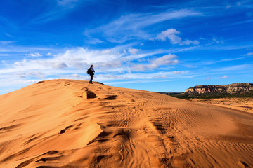 A Man taking picture in the desert, Coral Pink Sand Dunes State Park, Utah