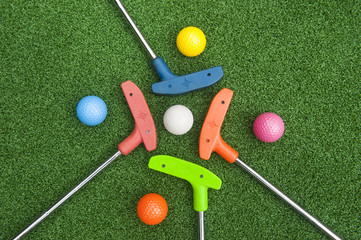 Deurstickers Golf Four Mini Golf Putters with Balls