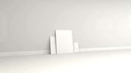 Blank white posters in white frames standing on the floor