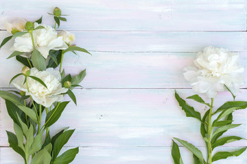 peonies on a wooden background, picture for a blog or article, wedding concept