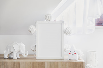 The modern sandinavian newborn baby room with mock up poster frame, cotton lamps and star. Sunny and bright interior.