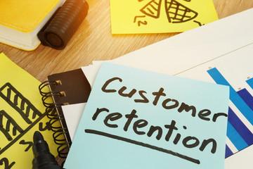 Customer retention written on a memo stick.