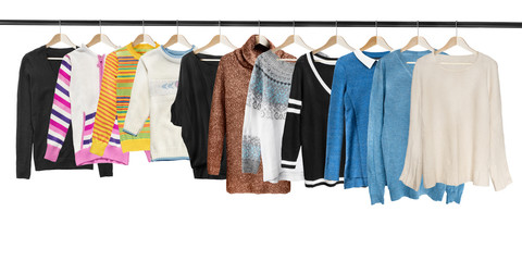 Hanging sweaters isolated
