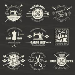 Tailor shop vector light emblems or badges on dark