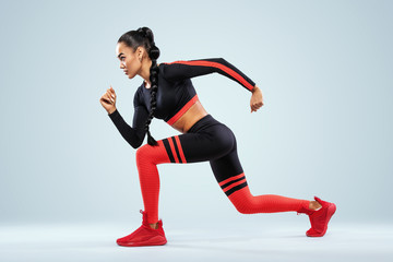 A strong athletic, women sprinter, running wearing in the sportswear, fitness and sport motivation. Runner concept with copy space. Dynamic movement