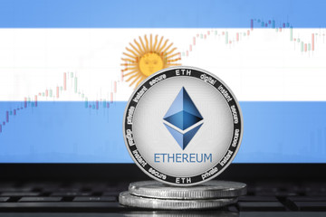 ETHEREUM (ETH) cryptocurrency; physical concept ethereum coin (token) on the background of the flag of ARGENTINA