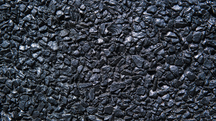 Texture of black stone wall captured with a daylight.