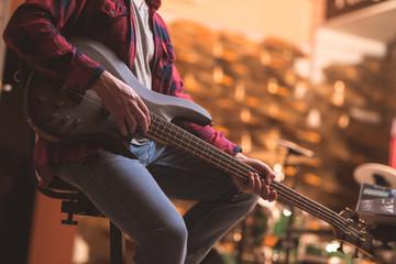 Young man playing bass guitar