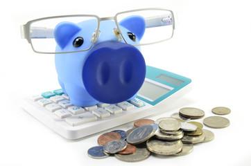 Blue piggybank with coins