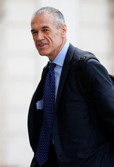 Former senior IMF official Carlo Cottarelli arrives before a meeting with the Italian President Sergio Mattarella at the Quirinal Palace in Rome