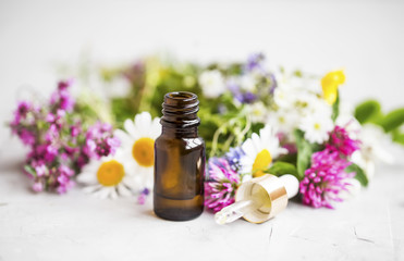 Essential oil with medicinal plants and flowers