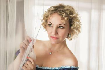 Beautiful romantic curly woman