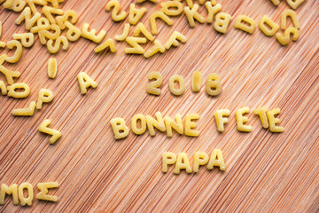 Pasta forming the text 2018 Bonne Fete Papa, meaning Happy Fathers Day in French