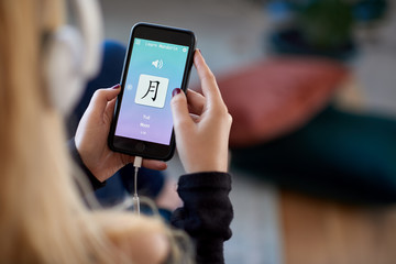 woman using foreign language learn chinese mobile phone app
