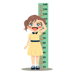 Cute little girl measuring her height with wall ruler