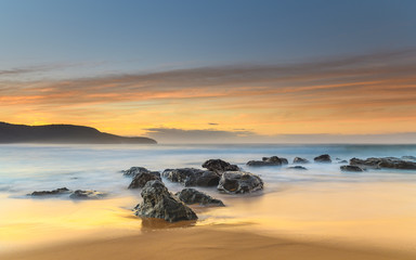 Soft Sunrise Seascape with Rocks
