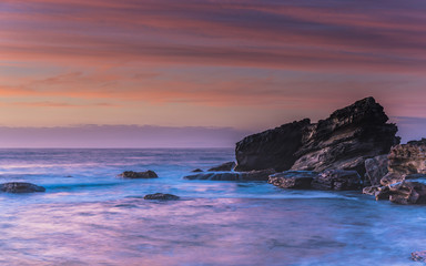 Sunrise Seascape and Rocky Outcrop