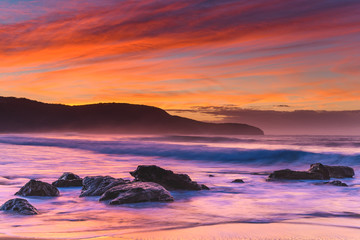 Vibrant Rocky Sunrise Seascape