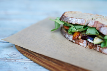 Delicious mixed vegetable sandwich resting on a wooden table