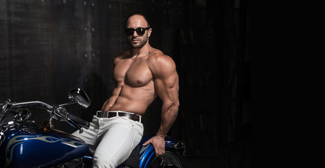 Sexy young handsome muscular biker