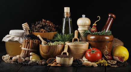 spices on black wooden background