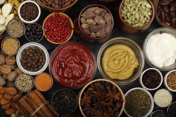 Photo sur Aluminium different spices on wooden background. top view