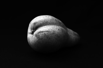 Erotic pear on a black background