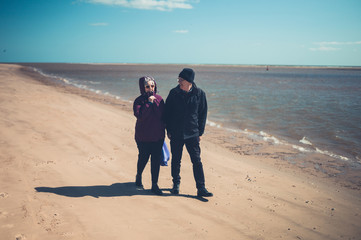 Senior couple enjoying walk on the beach