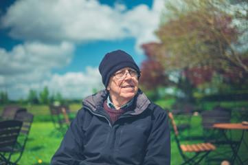 Senior man outdoors in garden