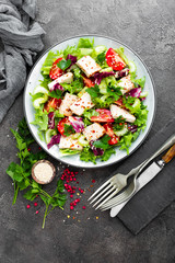 Meat salad with fresh vegetables. Vegetable salad with baked chicken breast. Vegetable salad with chicken fillet on plate