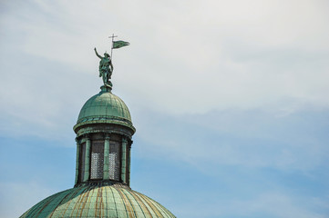 Close-up of sculpture on the dome top of the San Simeone Piccolo Church with blue sky, at the city of Venice, the historic and amazing marine city. Located in Veneto region, northern Italy