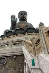 The enormous Tian Tan Buddha at Po Lin Monastery in Hong Kong, Giant Buddha on white background.
