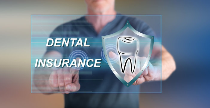 Man touching a dental insurance concept on a touch screen