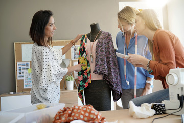 Fashion designer women working on garment pattern