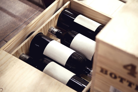 4 bottles of wine in a wooden box