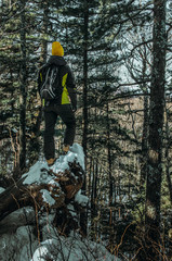a man in a winter forest high in the mountains