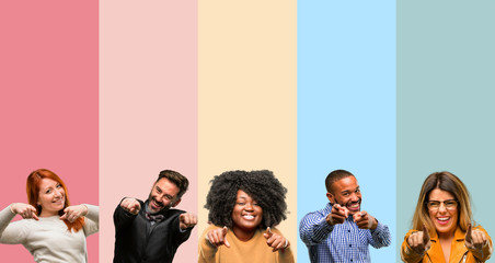 Cool group of people, woman and man pointing to the front with finger Wall mural