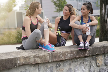 Group of athletic girls talking together after running
