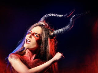 Black magic ritual of mad satan woman cry in hell on Halloween. Witch reincarnation mythical creature on Sabbath. Astral travel. Mythical zodiac Horoscope Capricorn Aries, Taurus astrology.