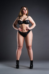Plus size sexy model in black lingerie, fat woman with big natural breasts, overweight female body