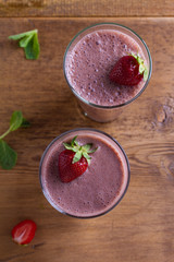Milkshake with chocolate and strawberries. Chocolate strawberry smoothie. View from above, top studio shot