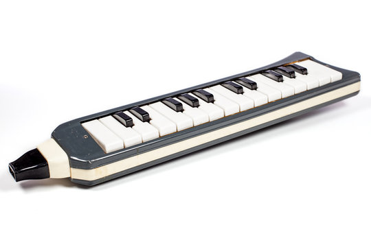 Melodica. Old childs musical instrument toy.