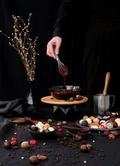 Confectioner prepares hot chocolate