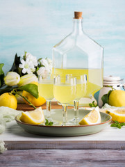 Home made limoncello served in stemmed glasses. Summer still life