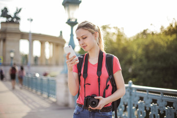 Tourist checking her phone