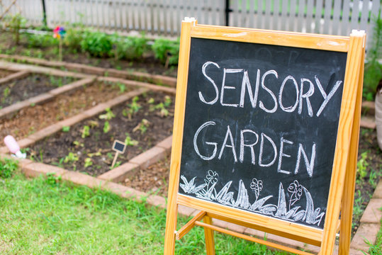 Chalk board next to the garden bed