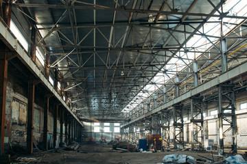 Large empty industrial hangar or storage warehouse interior